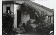 Marjory Stoneman Douglas with cat outside her home