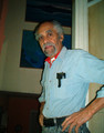 Photograph of the painter Mathew Barros at his home in Providence, winter 2004.